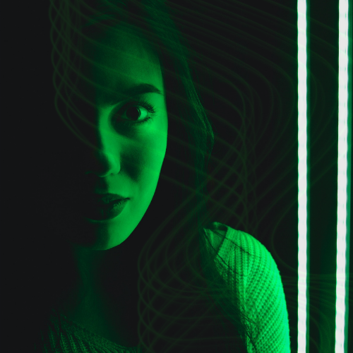 a woman shrouded by green light